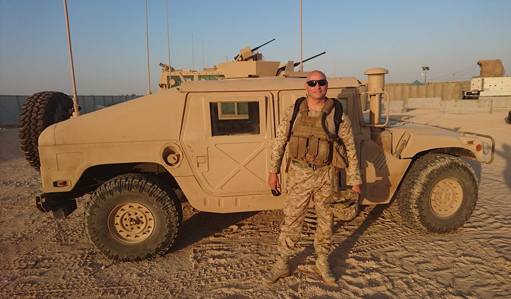 Standing next to Humvee